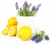 Still life with fresh lemons and lavender, isolated on white