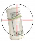 Closeup of hundred dollar bill isolated on white background with crosshairs symbolizing gunning for