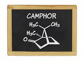 chemical formula of camphor on a blackboard
