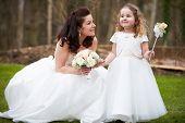 Bride With Bridesmaid On Wedding Day