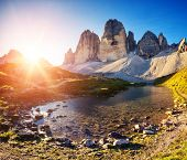 Great view of the sunny Lago Rienza - Ursprung in National Park Tre Cime di Lavaredo. Dolomites, Sou