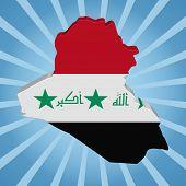 Iraq map flag on blue sunburst illustration