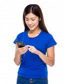 Woman send message via cellphone