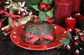 English Style Christmas Plum Pudding Dessert With Traditional Festive Decorations, Gold Reindeer And