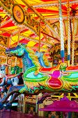 image of carousel horse  - View of Carousel with horses on a carnival Merry Go Round - JPG