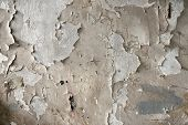 White peeling paint on the wall