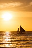 Sailboat At Sunset On A Tropical Sea. Silhouette Photo.