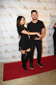 LOS ANGELES - SEP 10:  Janel Parrish, Valentin Chmerkovskiy at the Dance With Me USA Grand Opening a