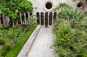 DUBROVNIK, CROATIA - MAY 26, 2014: Famous inner courtyard in the Monastery of the Friars minor in Du