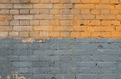 Texture Of Old Brick Walls Covered With Blue And Yellow