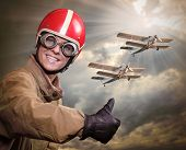 Happy pilot and biplanes.