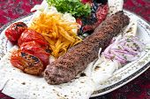 grilled koobideh with vegetables and flat bread