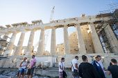 People Sightseeing Parthenon Temple In Greece