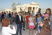 Tourists Sightseeing Temple Of Athena Nike In Acropolis