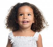Portrait of a small afro american girl with curly hair looking up and laughing isolated on white