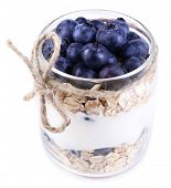 Healthy breakfast - yogurt with  blueberries and muesli served in glass jar, isolated on white