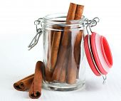 Cinnamon bark in glass bank on wooden table