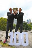 US Open 2014 men doubles champions Bob and Mike Bryan posing with trophy in Central Park