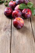 Sweet plums on wooden background