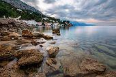 Rocky Beach And Small Village Near Omis In The Morning, Dalmatia, Croatia