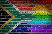 stock photo of transgender  - Dark brick wall texture  - JPG