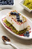 Fancy Panna Cotta With Blueberries And Pistachio
