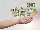 Concept or conceptual abstract sport and health word cloud man hand, rainbow sky background