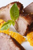 picture of roast duck  - slices of roasted duck meat fillet with orange and basil close - JPG