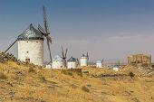 Six Spanish windmills in a row