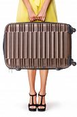 Girl is holding brown suitcase