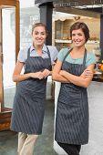 Pretty waitresses smiling at camera at the coffee shop