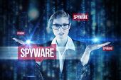 The word spyware and businesswoman holding hand out in presentation against lines of blue blurred le