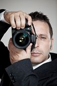 Photographer In Business Suit