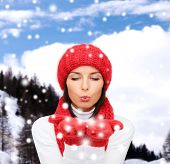 happiness, winter holidays, tourism, travel and people concept - smiling young woman in red hat and