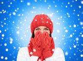 happiness, winter holidays, christmas and people concept - smiling young woman in red hat, scarf and