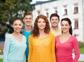 friendship, education, summer vacation and people concept - group of smiling teenagers standing over