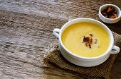 picture of chanterelle mushroom  - pumpkin soup with chanterelles on a dark wood background - JPG