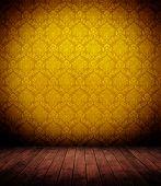 grunge wooden interior with elegant yellow wallpaper (baroque).