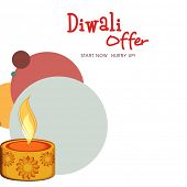Beautiful floral design decorated oil lit lamp on creative colorful background for Diwali festival o