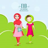 Young Muslim ladies with gift box on nature background for Muslim community festival Eid-Ul-Adha cel