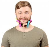 Portrait of handsome man with beard of curlers isolated on white