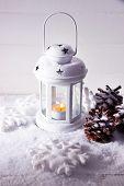 White flash light and Christmas decoration on light background