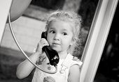 Toddler Girl Talking By The City Phone