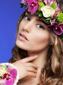 Gorgeous Woman With Bouquet Of Colorful Flowers
