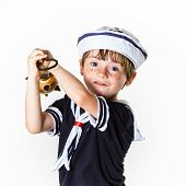 Little Boy Dressed In Sailor Suit