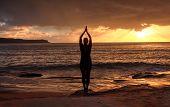 Woman Tadasana  -  Mountain Pose  Yoga By The Sea At Sunrise