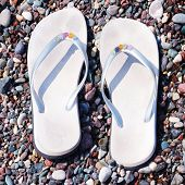 Flip-flops On A Pebble Beach Background