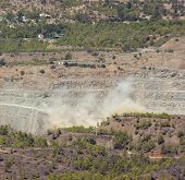 foto of asbestos  - A cloud forms over an Cyprus asbestos mine after an explosion - JPG