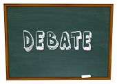 Debate word written on a chalkboard as a lesson from teacher to student in debating class learning s