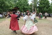 MUSKOGEE, OK - MAY 24: People dressed in historical costumes dance at the Oklahoma 19th annual Renai